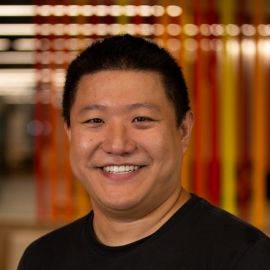 Close up photo of a man (Anthony Zhang)